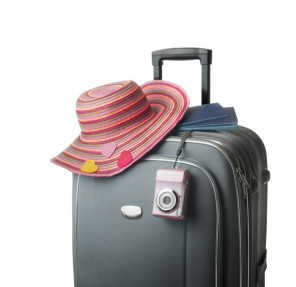 isolated suitcase with female accessories