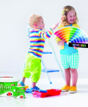 Family remodeling house. Home remodel and renovation. Kids painting walls with colorful brush and roller. Children paint wall. Choice of bright color on sample palette for child nursery or kid room.
